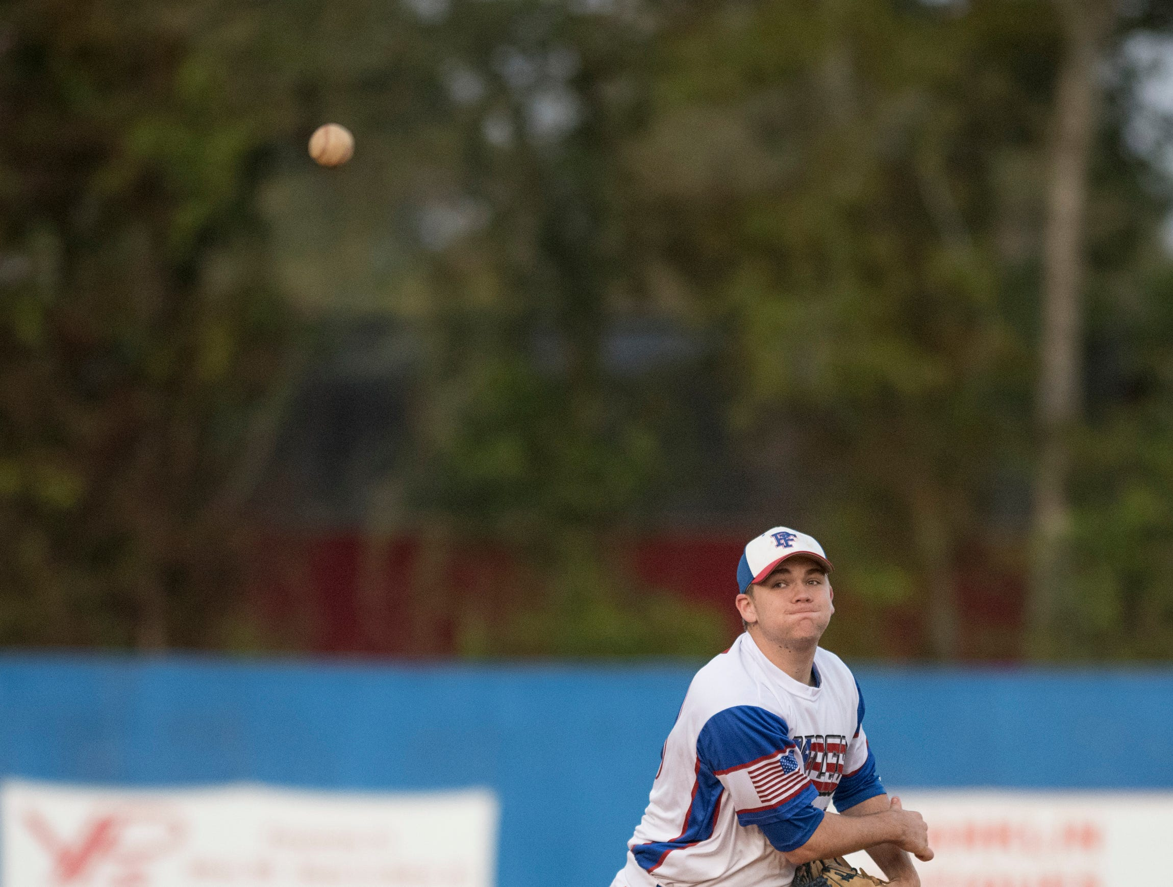 Shortstop Timmy Williams (20) tosses to first base while warming up in between innings during the Christian Educational Consortium vs Pine Forest baseball game at Pine Forest High School in Pensacola on Wednesday, April 3, 2019.