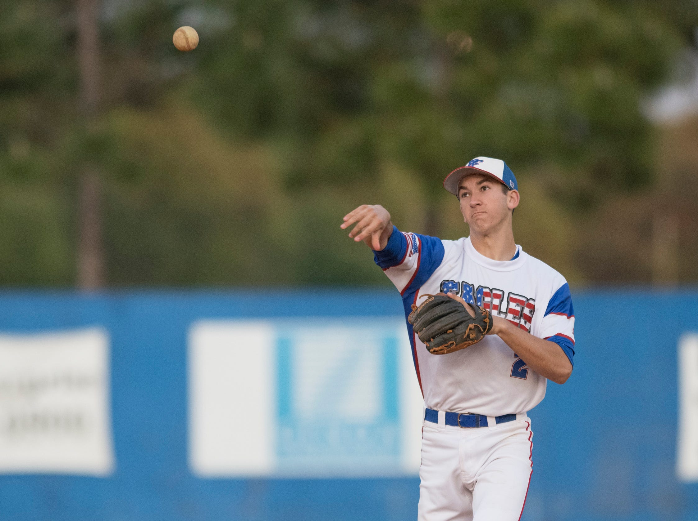 Second baseman John Pinette (2) tosses to first base while warming up in between innings during the Christian Educational Consortium vs Pine Forest baseball game at Pine Forest High School in Pensacola on Wednesday, April 3, 2019.