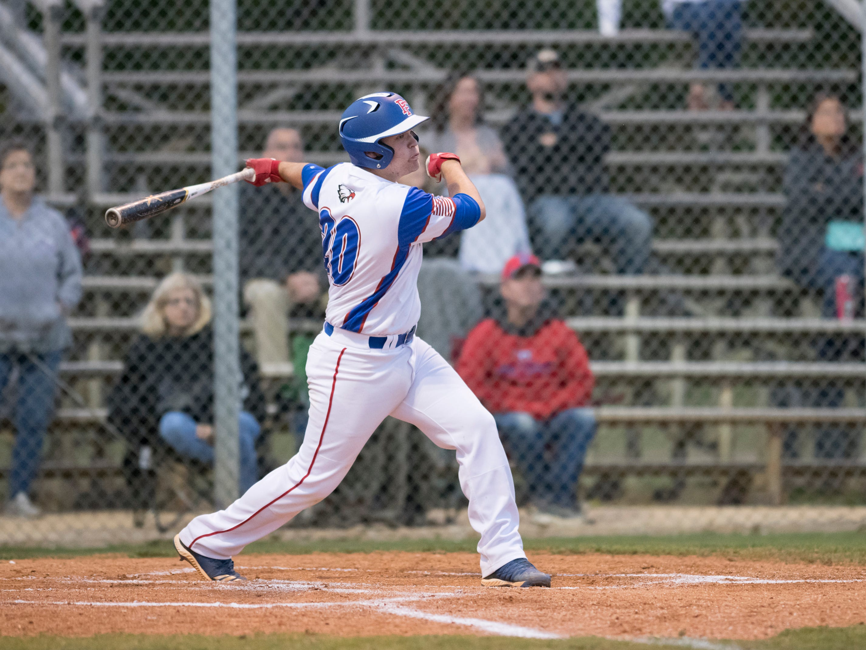 Timmy Williams (20) watches his shot after making contact during the Christian Educational Consortium vs Pine Forest baseball game at Pine Forest High School in Pensacola on Wednesday, April 3, 2019.