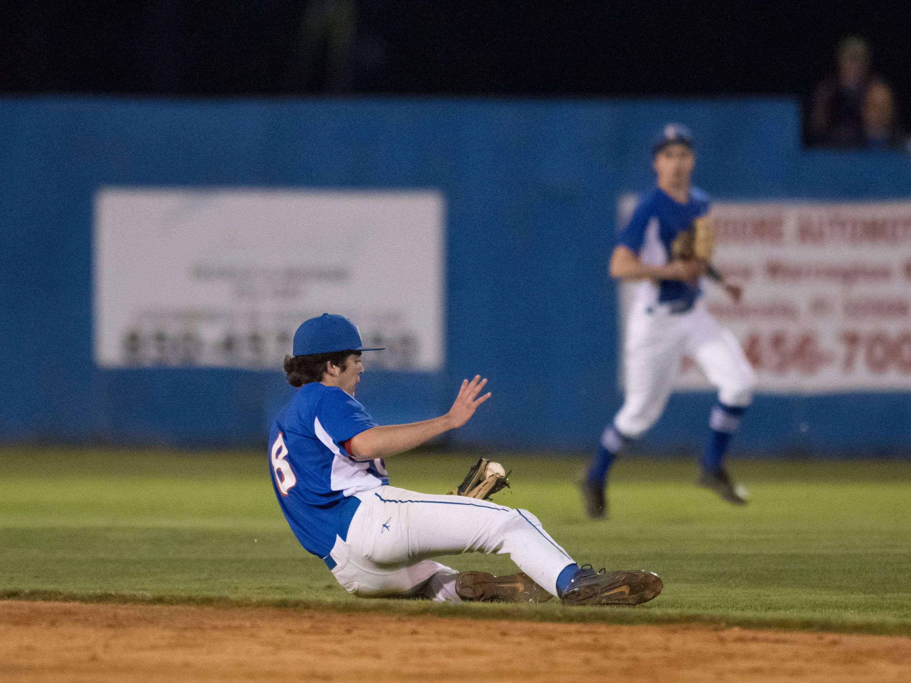Sawyer Dibble (8) slides to catch Chase Gullatt (5)'s pop up for the third out in the bottome of the 2nd inning during the Christian Educational Consortium vs Pine Forest baseball game at Pine Forest High School in Pensacola on Wednesday, April 3, 2019.