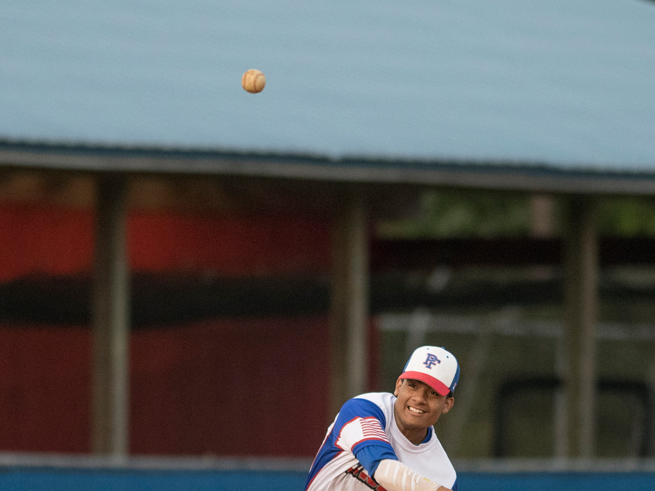 Third baseman Christian Munoz (9) tosses to first base while warming up in between innings during the Christian Educational Consortium vs Pine Forest baseball game at Pine Forest High School in Pensacola on Wednesday, April 3, 2019.