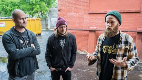 From left, Blake Foster, Ryan Brei and Brett Schweigert are the three minds behind Odd Colony Brewing Co., a new local brewery opening in July at 260 N. Palafox St.