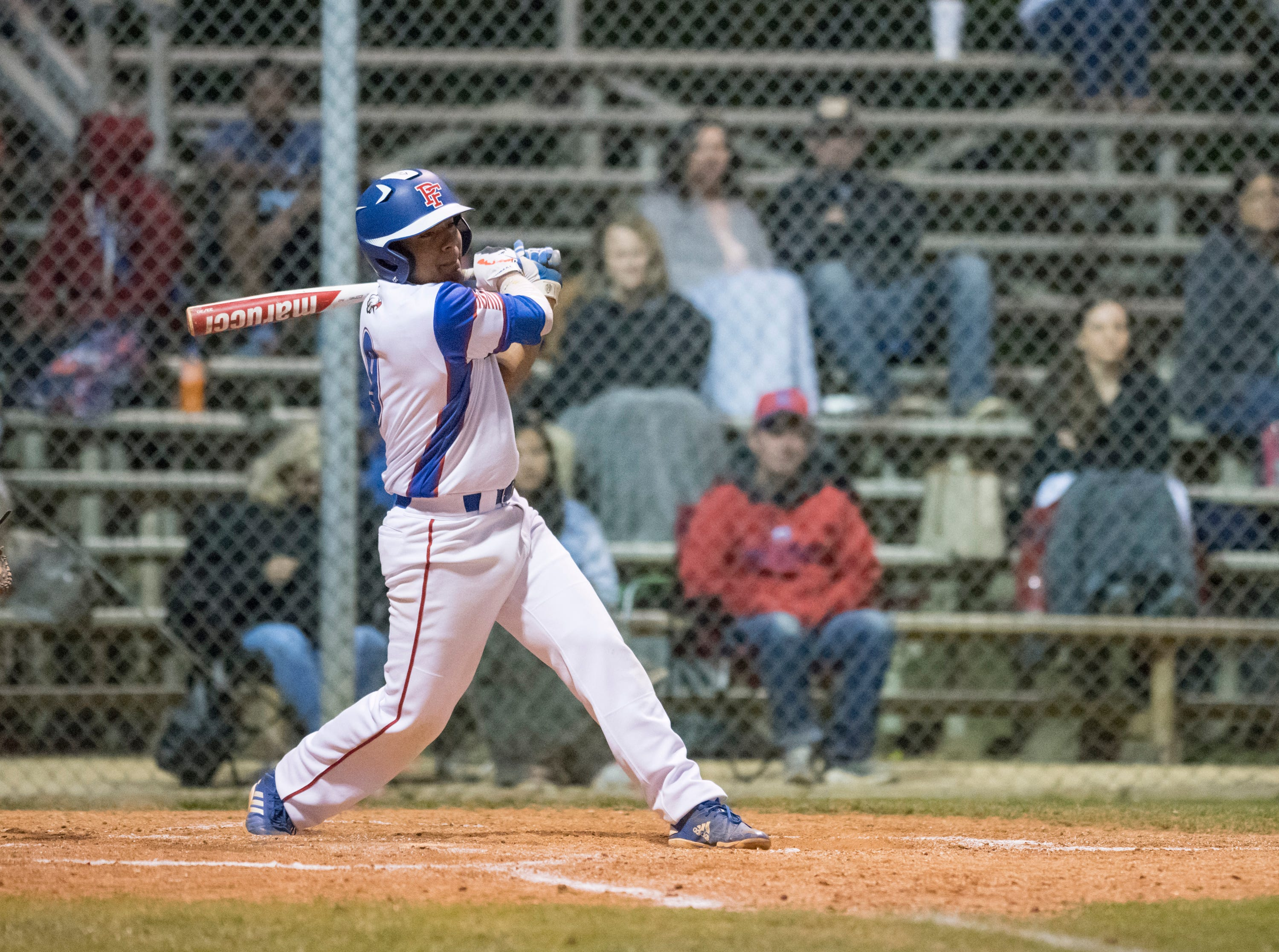 Christian Munoz (9) follows through as he hits a single during the Christian Educational Consortium vs Pine Forest baseball game at Pine Forest High School in Pensacola on Wednesday, April 3, 2019.