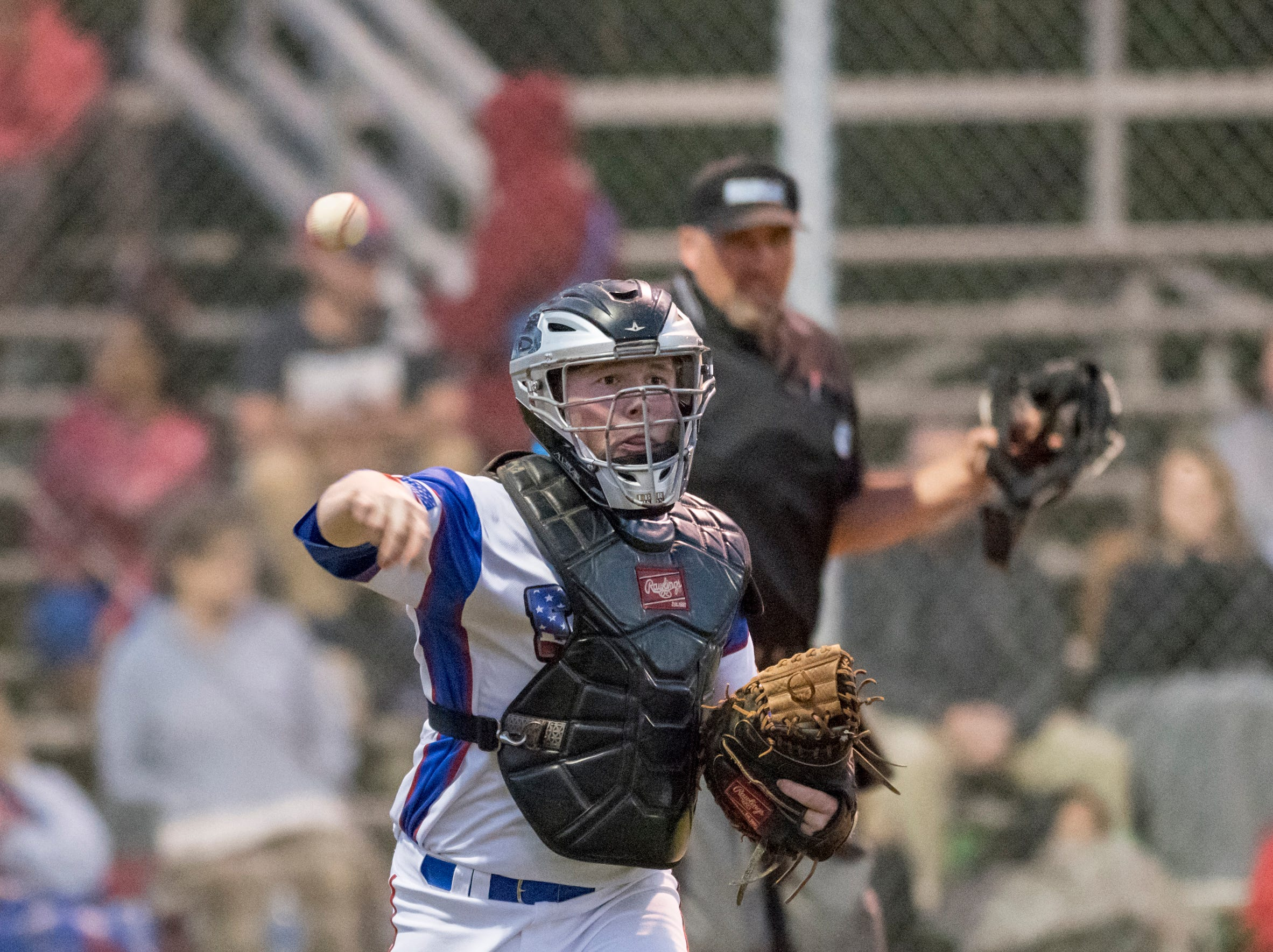 Catcher Jason Roberts (15) tosses to first for an out after a dropped third strike during the Christian Educational Consortium vs Pine Forest baseball game at Pine Forest High School in Pensacola on Wednesday, April 3, 2019.