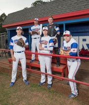 Eagles baseball players Nolan Rigby (12), clockwise from top left, Jason Roberts (15), Timmy Williams (20), Tekoah Roby (10), and John Pinette (2) pose in the dugout at Pine Forest High School in Pensacola on Wednesday, April 3, 2019.
