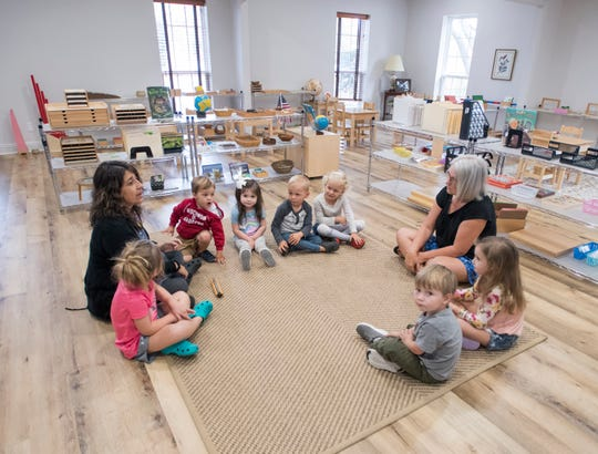 Fran Welch, left,  and Debbie Cook teach children the days of the week at the new Montessori School in Gulf Breeze on Thursday, April 4, 2019.