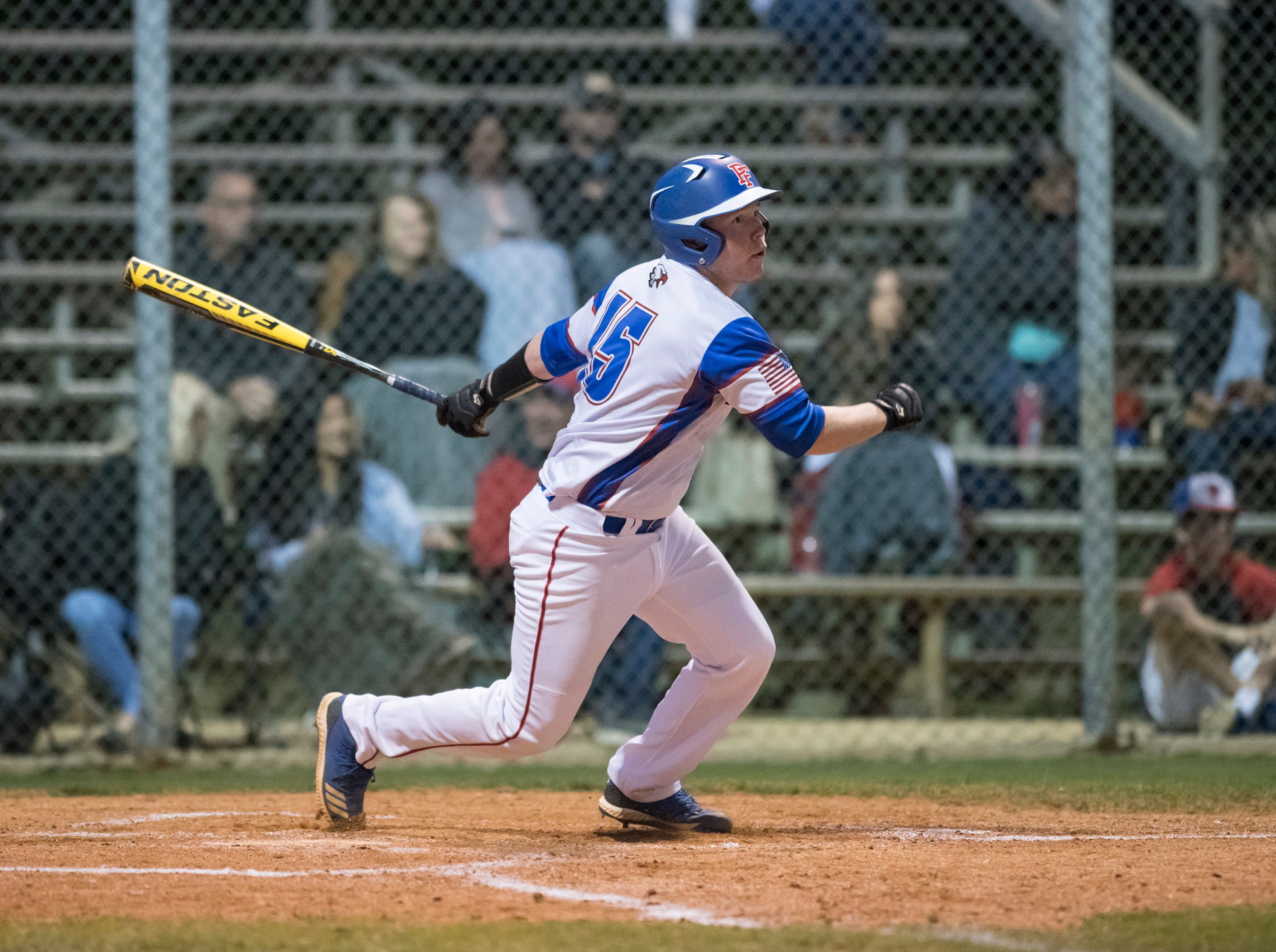Jason Roberts (15) follows his shot that fell in for a single during the Christian Educational Consortium vs Pine Forest baseball game at Pine Forest High School in Pensacola on Wednesday, April 3, 2019.