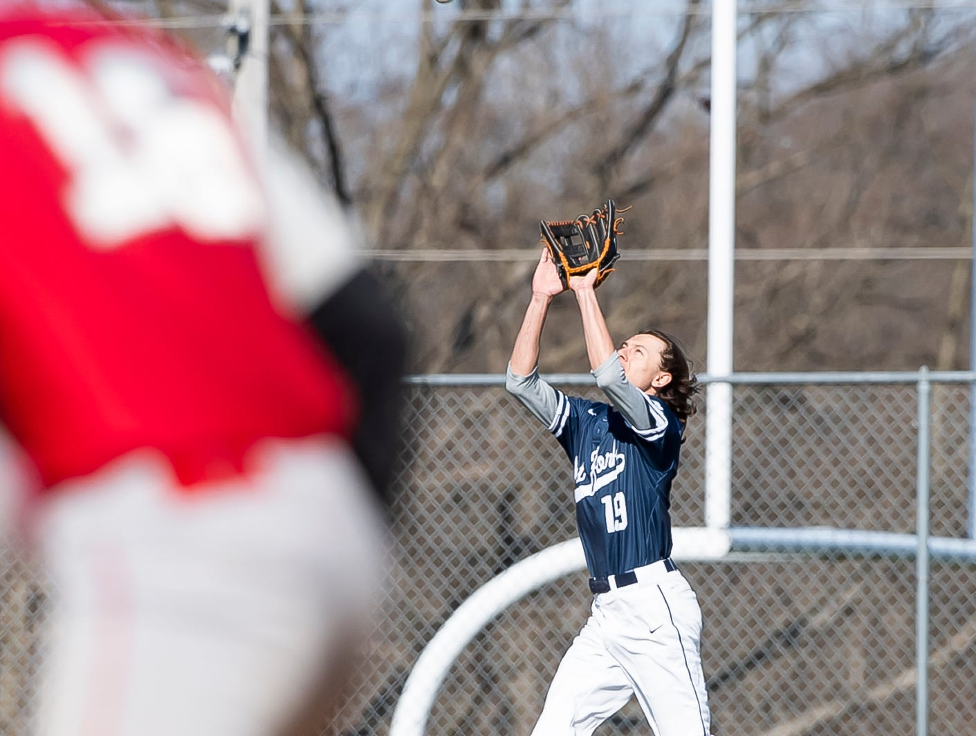 West York outfielder Christian Fletcher catches a fly ball to record an out during a YAIAA baseball game against Bermudian Springs on Wednesday, April 3, 2019. The Bulldogs won 14-11.