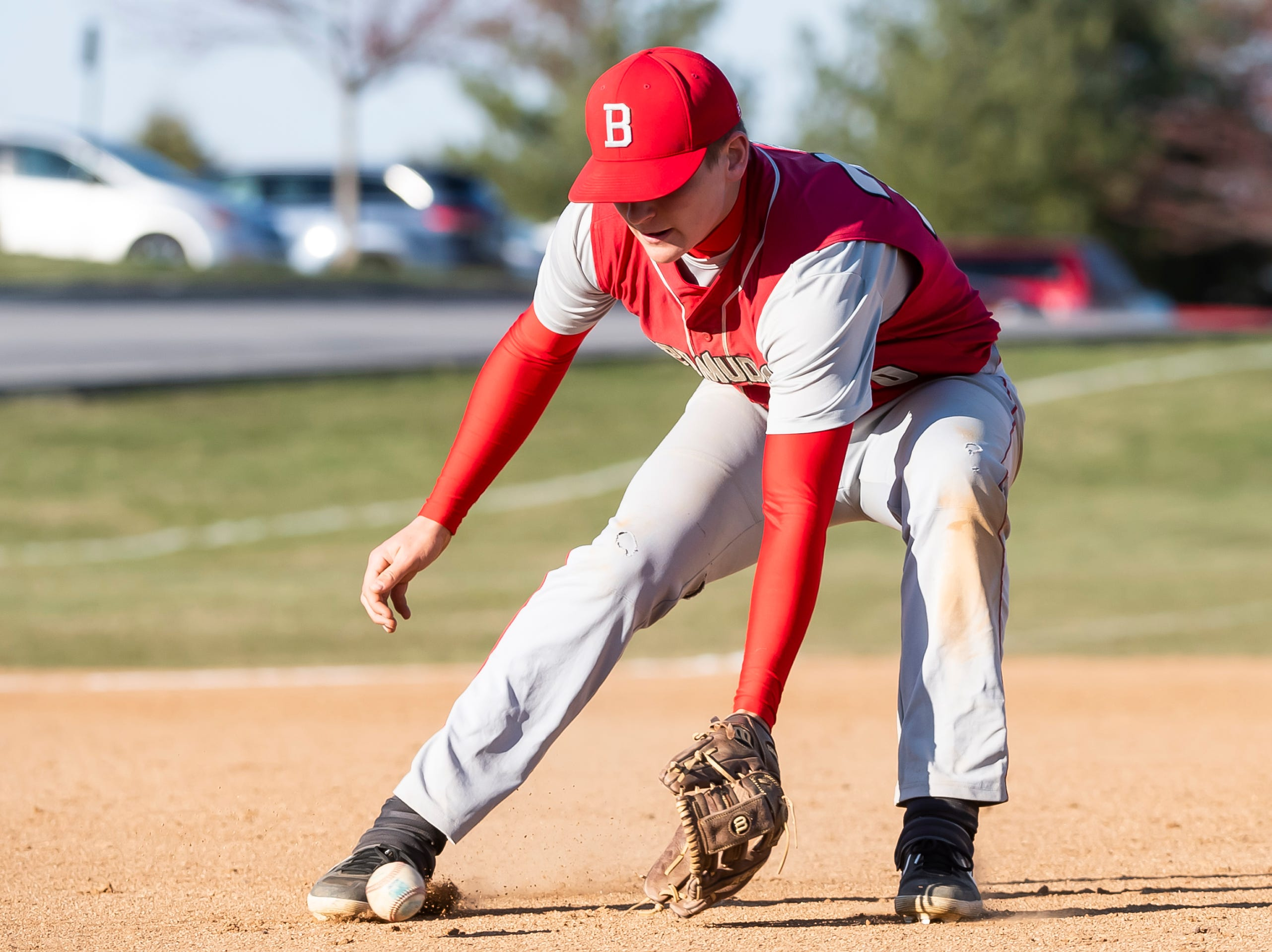 Bermudian Springs' pitcher Tyler Reinert scoops up a hit back to the mound during a YAIAA baseball game against West York on Wednesday, April 3, 2019. The Eagles fell 14-11.