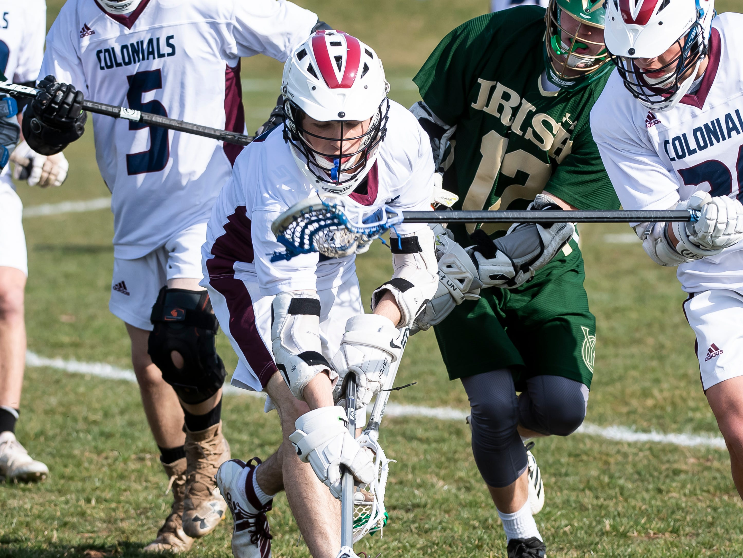 New Oxford's Connor Eisenhart tries to scoop up a ground ball during a YAIAA boys' lacrosse game against York Catholic on Thursday, April 4, 2019. York Catholic won 14-8.