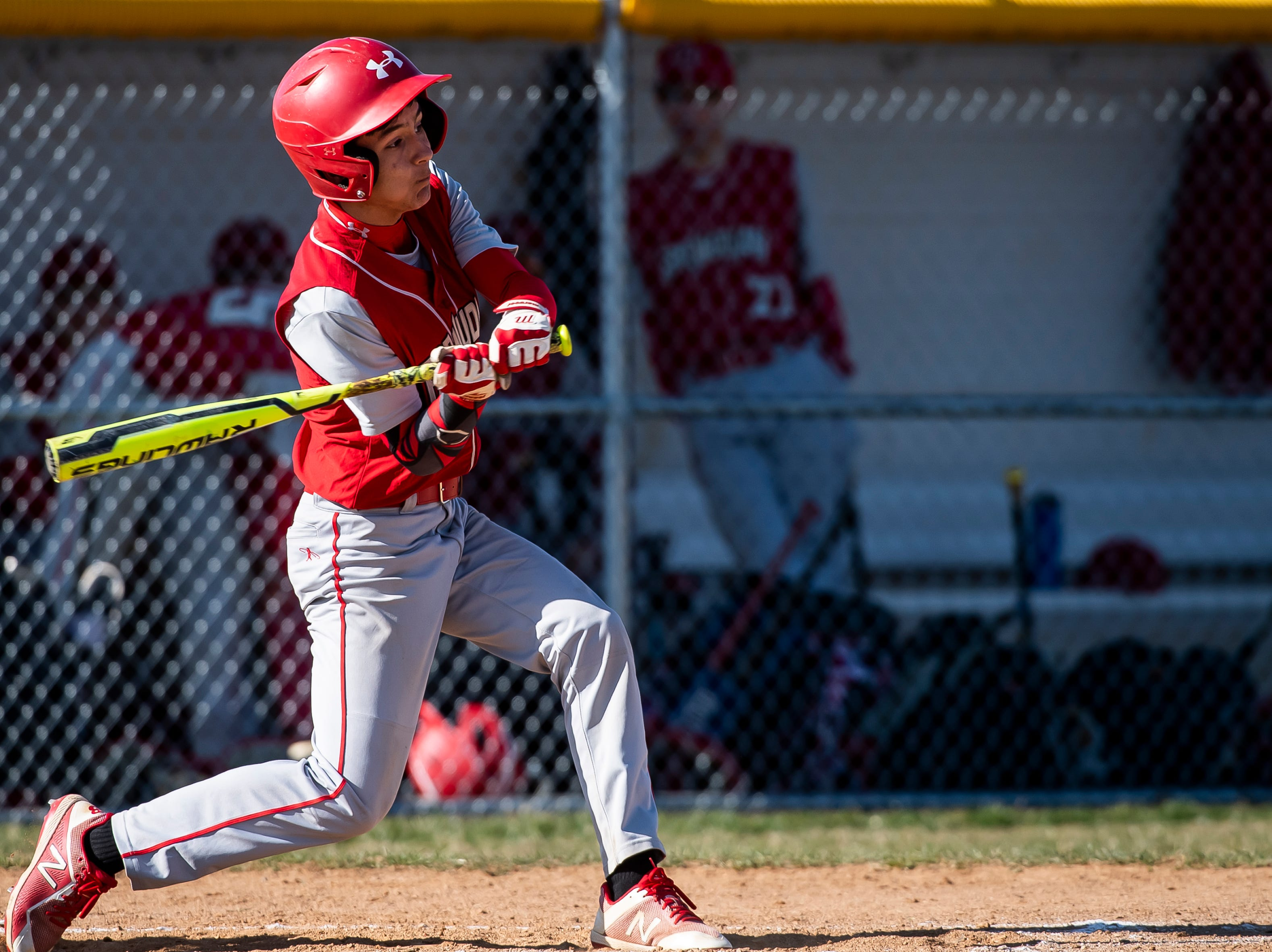 Bermudian Springs' Justice Taylor swings at a pitch during a YAIAA baseball game against West York on Wednesday, April 3, 2019. The Eagles fell 14-11.