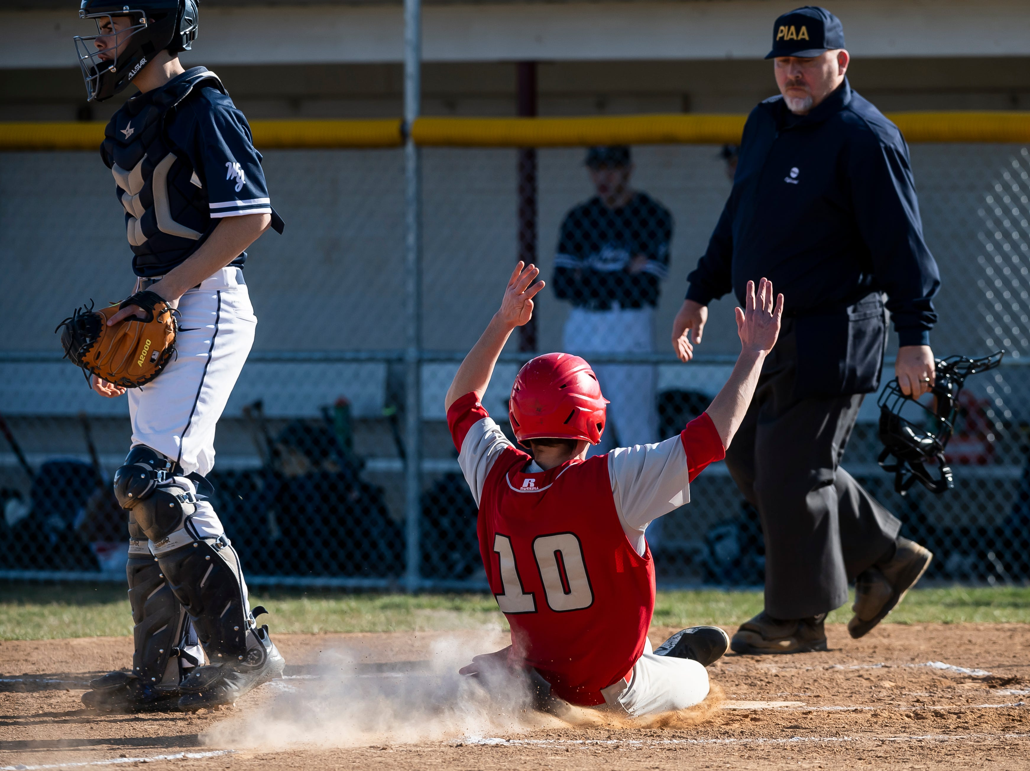 Bermudian Springs' Aden Juelich slides safely into home plate to score a run during a YAIAA baseball game against West York on Wednesday, April 3, 2019. The Eagles fell 14-11.
