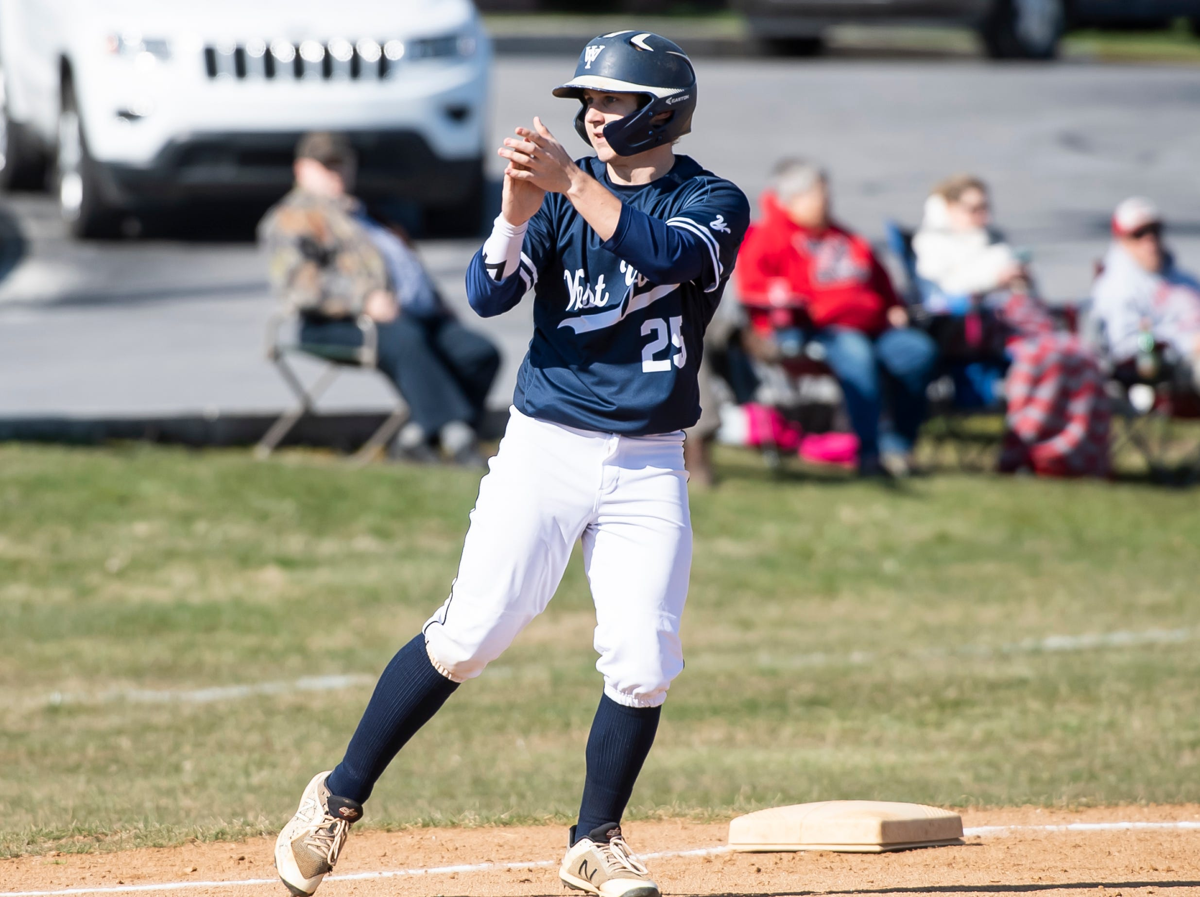 West York's Noah Marshall (25) claps after the Bulldogs score a run during a YAIAA baseball game against Bermudian Springs on Wednesday, April 3, 2019. The Bulldogs won 14-11.