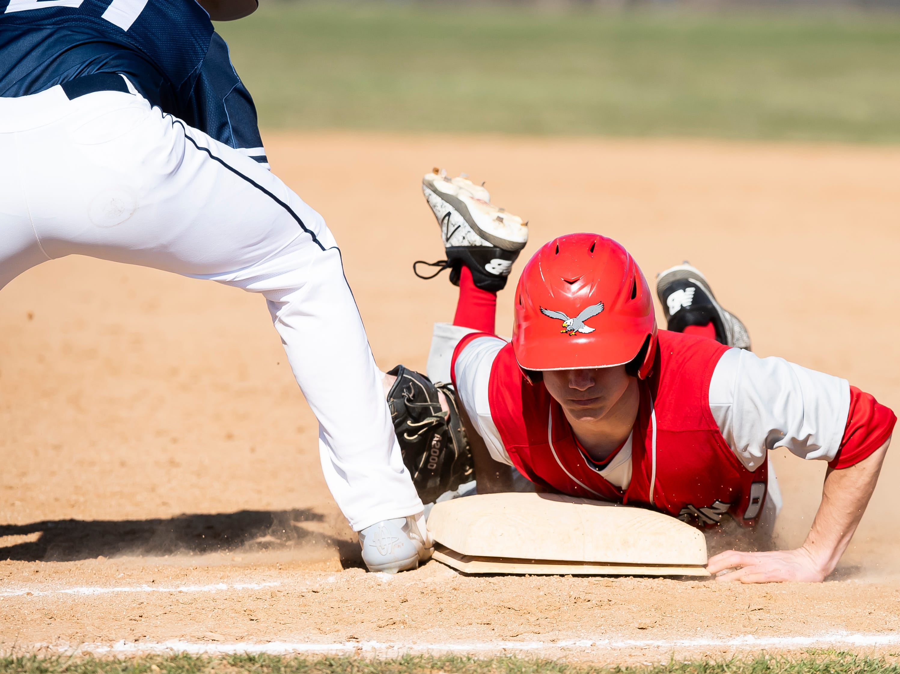 Bermudian Springs' Aden Juelich gets back to the bag safely during a YAIAA baseball game against West York on Wednesday, April 3, 2019. The Eagles fell 14-11.