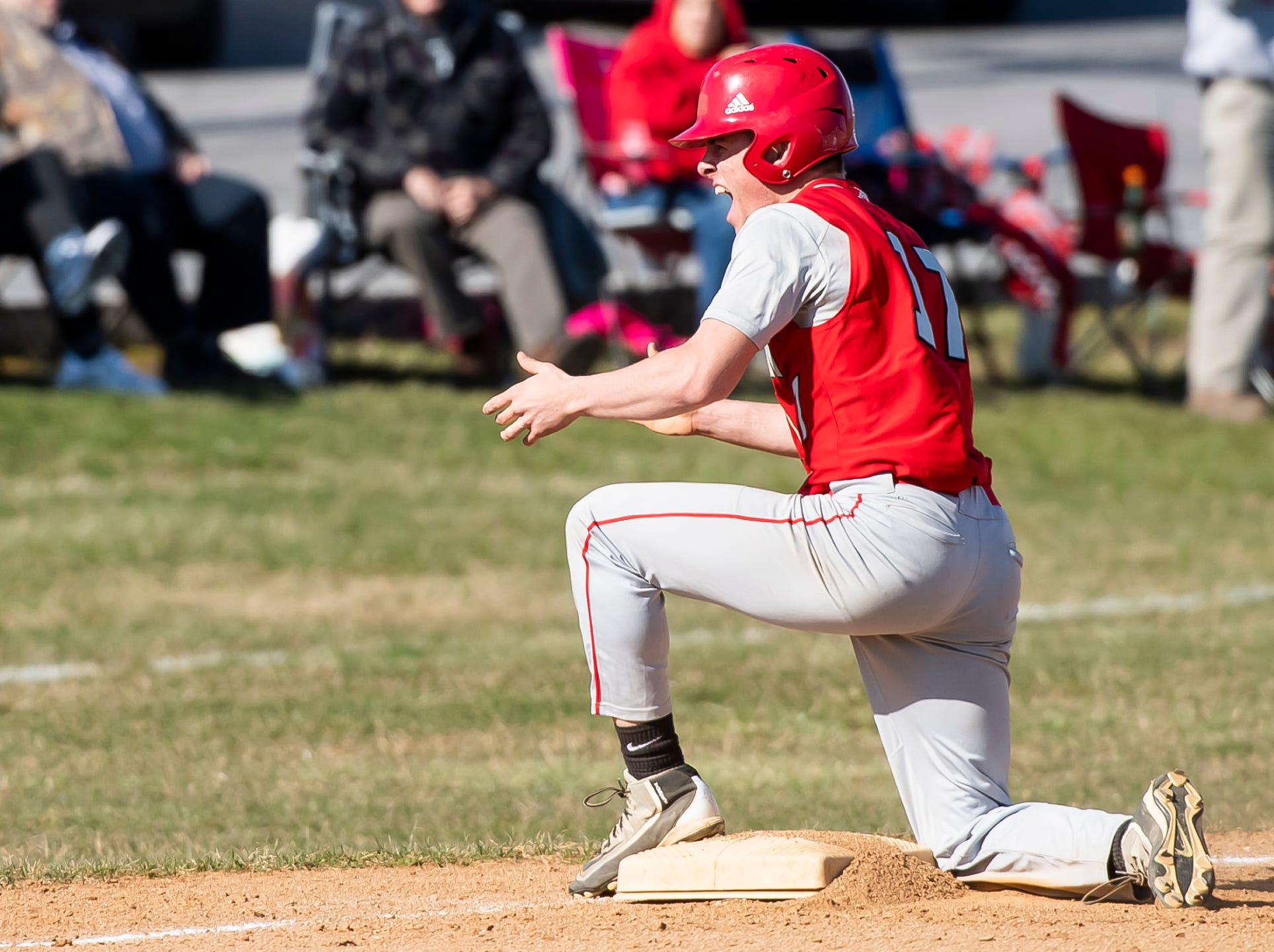 Bermudian Springs' Nate McCollum reacts after driving in two runs on a triple during a YAIAA baseball game against West York on Wednesday, April 3, 2019. The Eagles fell 14-11.
