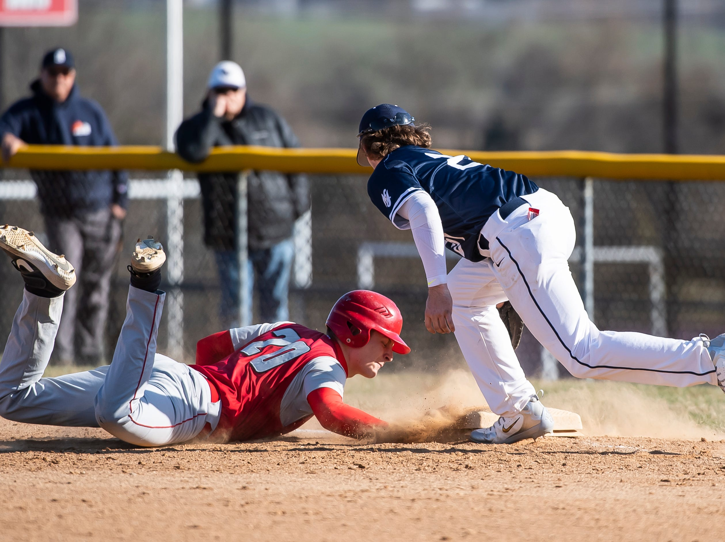 Bermudian Springs' Tyler Reinert gets back to first base safely during a pickoff attempt in a YAIAA baseball game against West York on Wednesday, April 3, 2019. The Eagles fell 14-11.