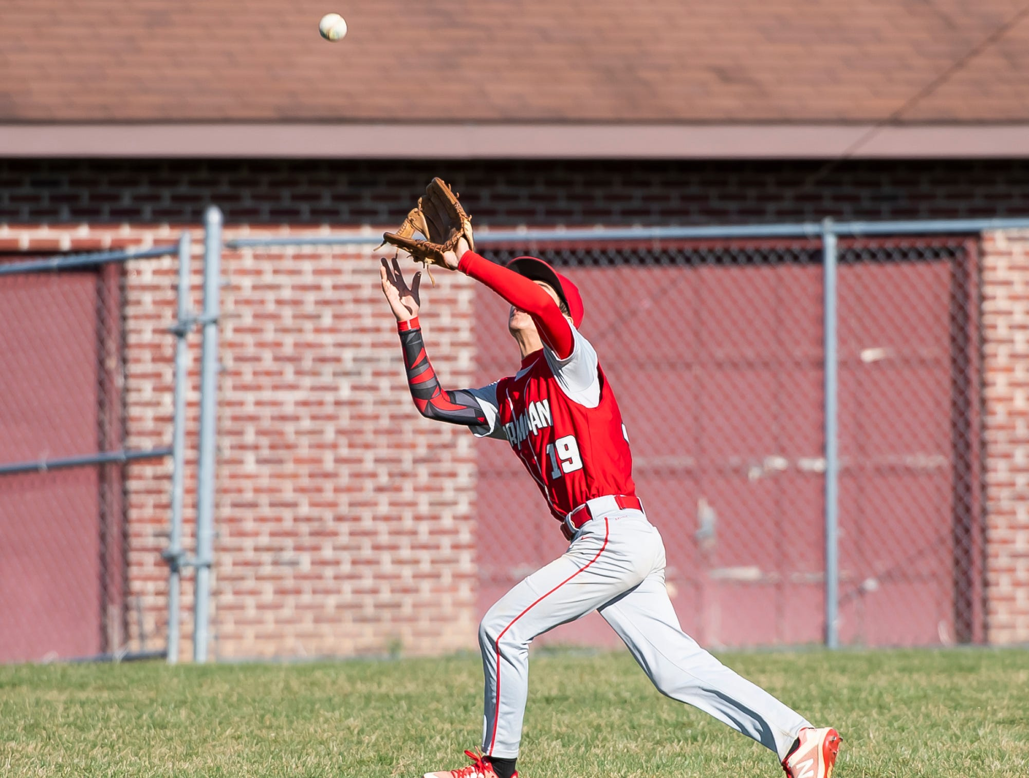 Bermudian Springs' Justice Taylor catches a fly ball during a YAIAA baseball game against West York on Wednesday, April 3, 2019. The Eagles fell 14-11.