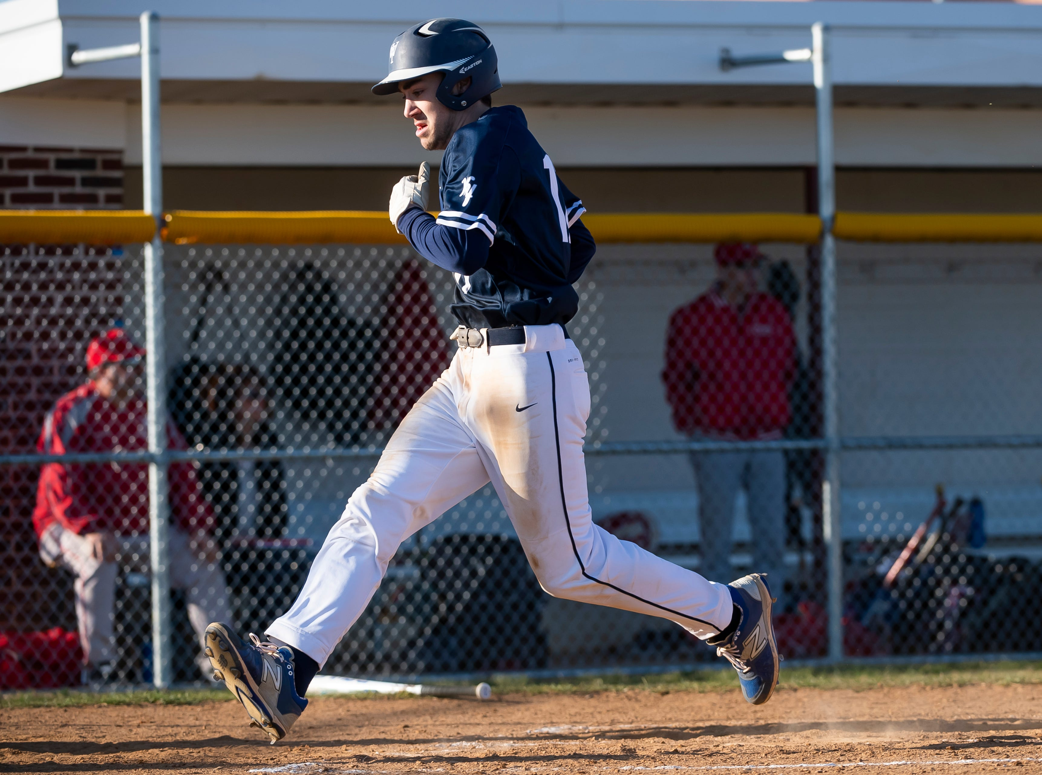 West York's Jeff Minot dashes across home plate to score a run during a YAIAA baseball game against Bermudian Springs on Wednesday, April 3, 2019. The Bulldogs won 14-11.