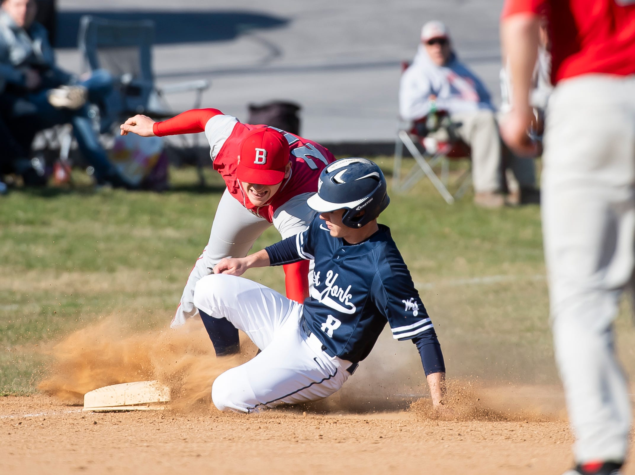 West York's Trent Ketterman slides safely into third base during a YAIAA baseball game against Bermudian Springs on Wednesday, April 3, 2019. The Bulldogs won 14-11.