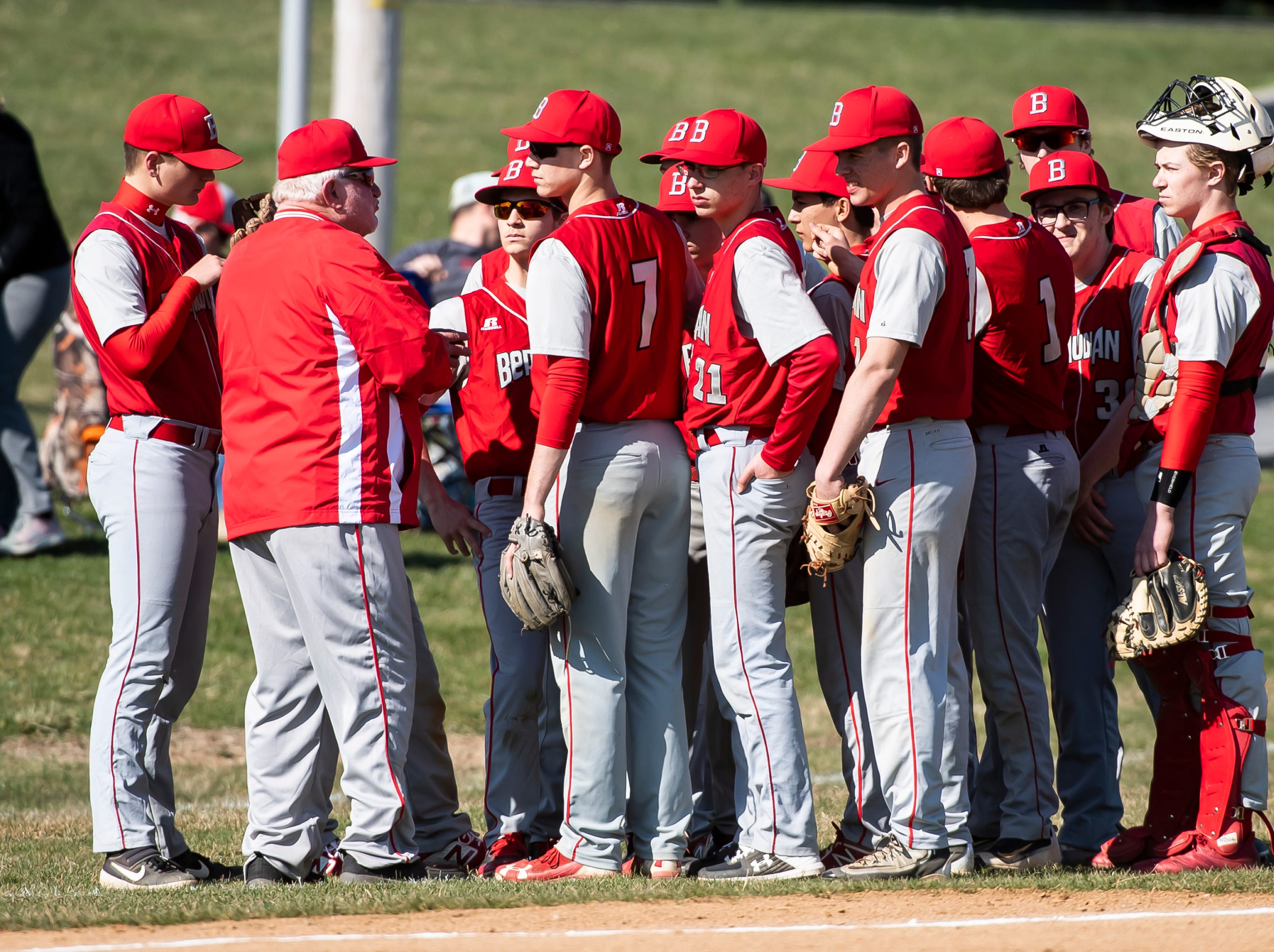 Bermudian Springs baseball head coach Bruce Reinert, left, speaks with his team before the start of a YAIAA game against West York on Wednesday, April 3, 2019. The Eagles fell 14-11.