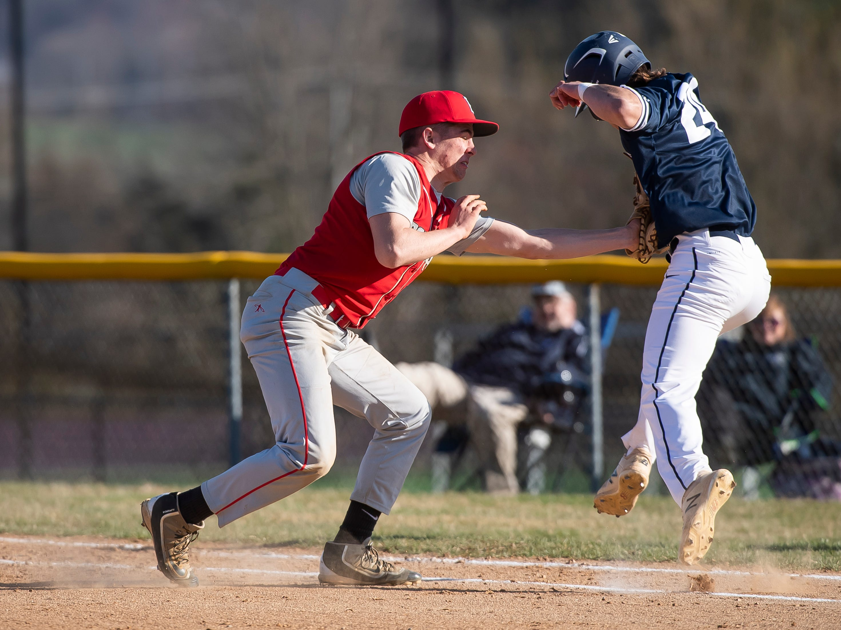 Bermudian Springs first baseman Nate McCollum tags out West York's Blaise Tanner during a YAIAA baseball game on Wednesday, April 3, 2019. The Eagles fell 14-11.