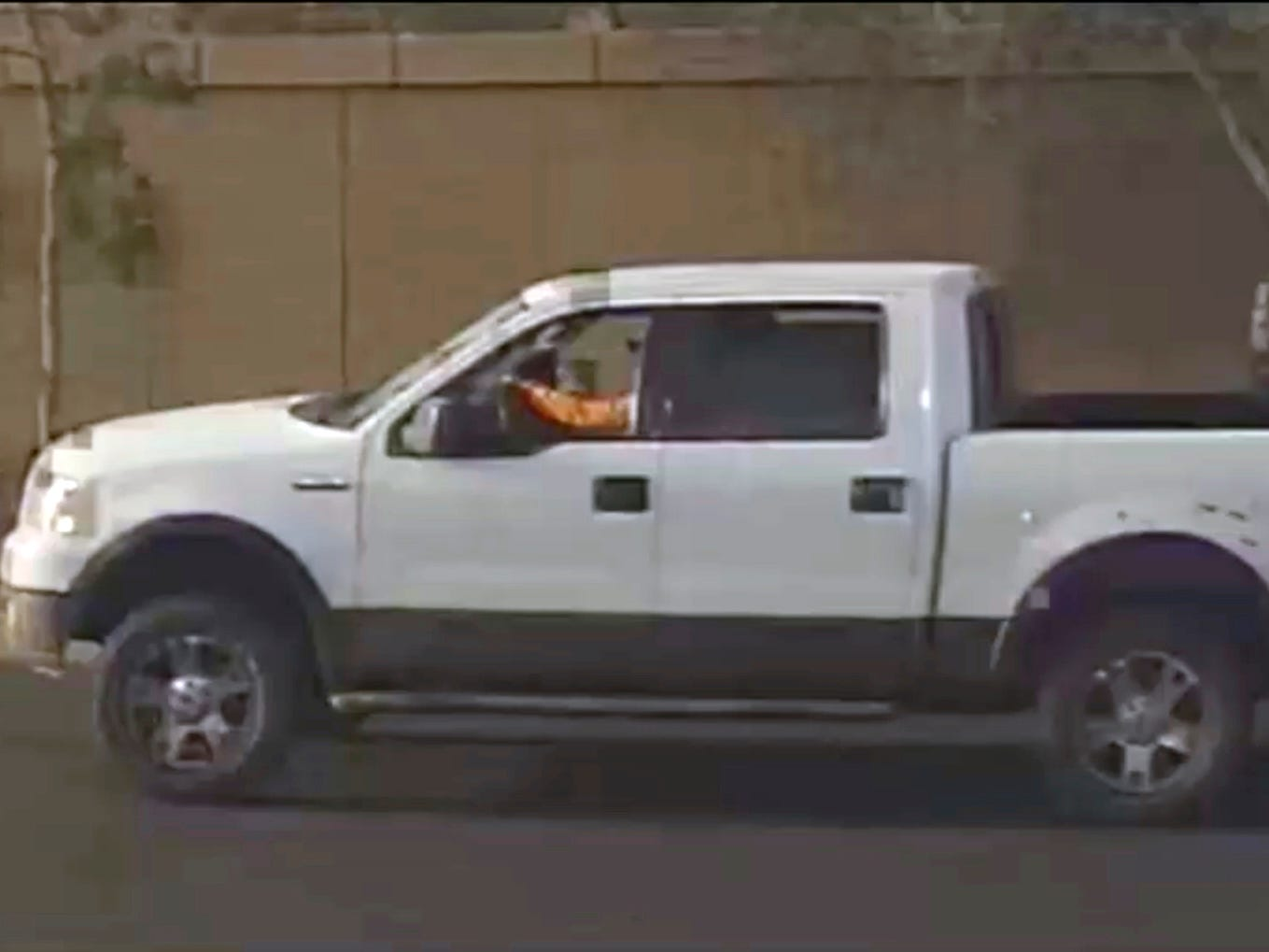 This photo, provided by the Phoenix Police Department, shows a security video photo of what is believed to be the shooter's vehicle in a possible road-rage incident in Phoenix, where a 10-year-old girl was fatally shot. Sgt. Vince Lewis said the shooting that killed Summer Bell Brown occurred April 3, 2019, when a man in a pickup truck that had been following a family's car fired several gunshots after the family pulled into their driveway.