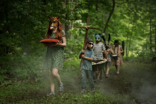 "An unsettling procession occurs on the Creed family property in ""Pet Sematary."""