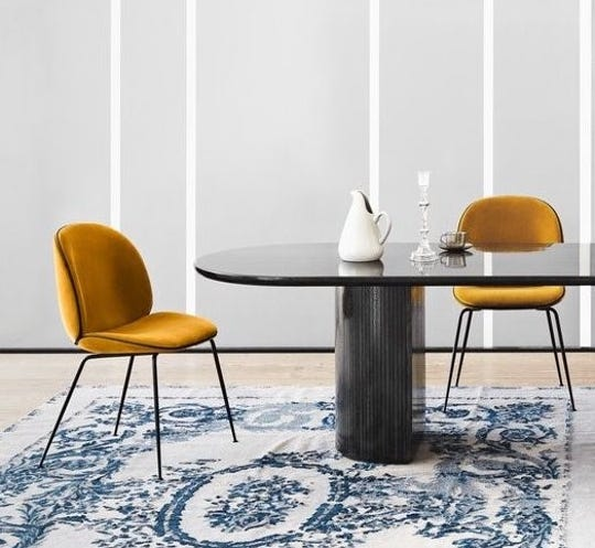The iconic Beetle chairs by GUBI of Copenhagen infuse color and texture into your home.