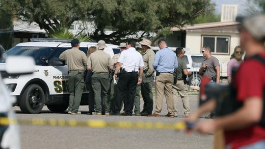 """Investigators from the Pima County Sheriff's Department are on scene after receiving """"a report of multiple gunshot victims,"""" at a house in the 2400 block of W. Kessler Place on April 04, 2019."""