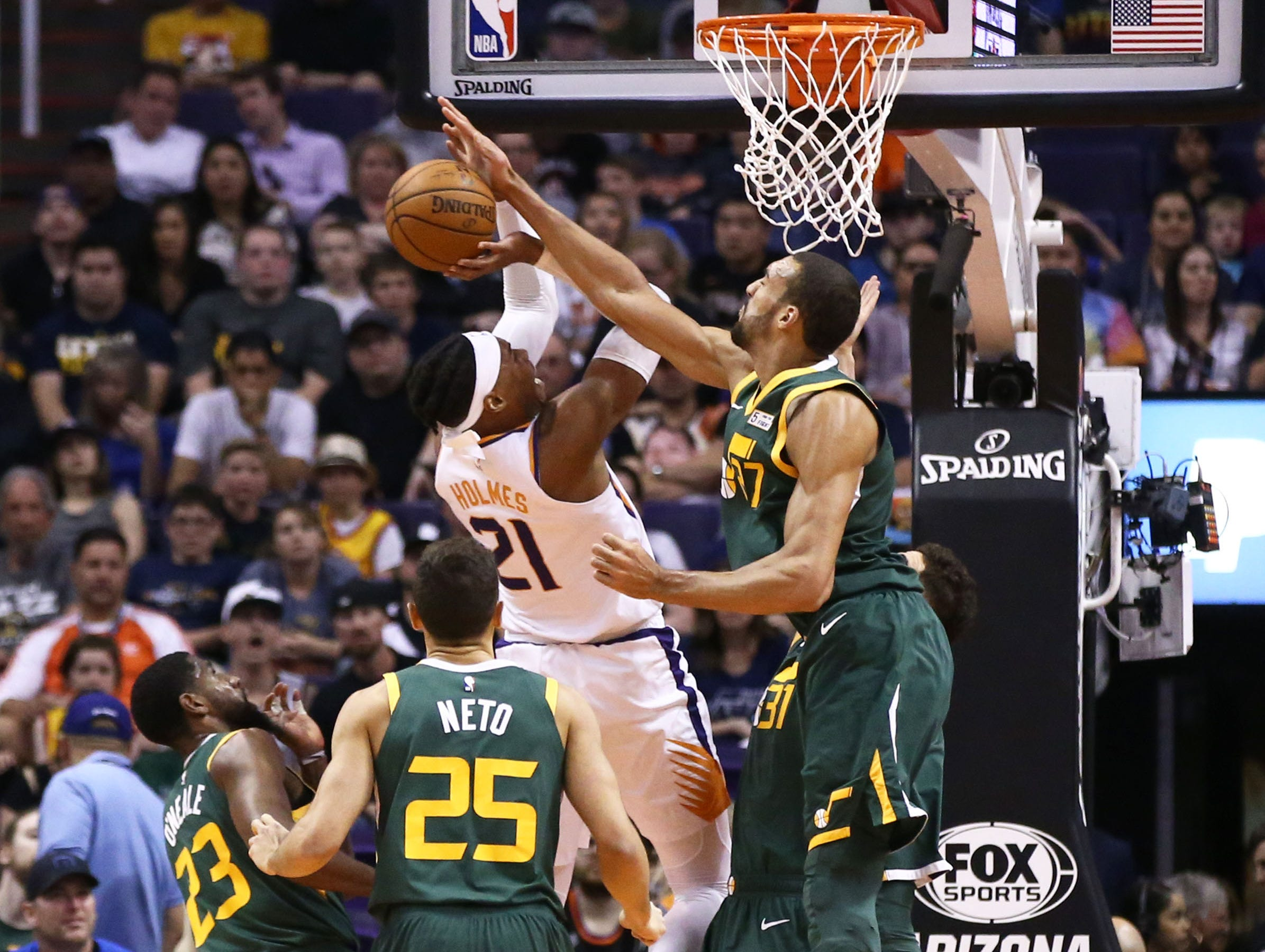 Utah Jazz center Rudy Gobert (27) blocks the shot by Phoenix Suns forward Richaun Holmes (21) in the first half on Apr. 3, 2019 at Talking Stick Resort Arena in Phoenix, Ariz.