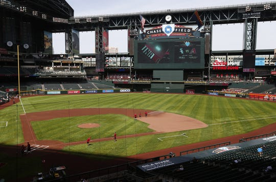 Chase Field will no longer feature the iconic dirt strip between the mound and home plate.