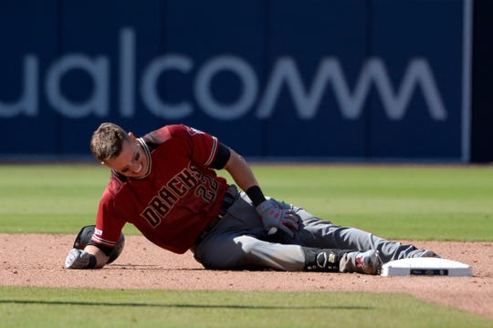 Apr 3, 2019: Arizona Diamondbacks third baseman Jake Lamb (22) grabs at his leg after an RBI double in the ninth inning against the San Diego Padres at Petco Park.