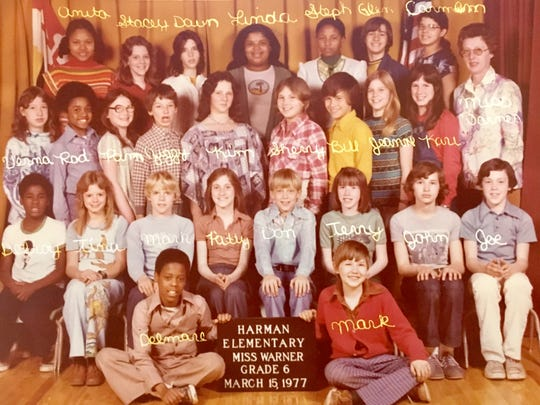 Stephanie Taylor, third from the right in the back row, and Karina Bland, standing next to the teacher in the second row, met in sixth grade.