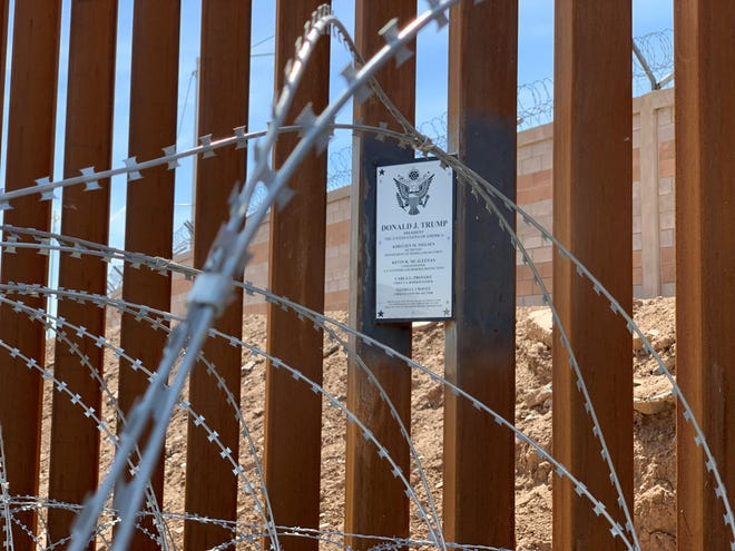 Trump's plaque at the border.