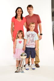 Phoenix Mercury coach Sandy Brondello and her husband Olaf Lange with their children Brody and Jayda after the Mercury's 2014 WNBA championship.