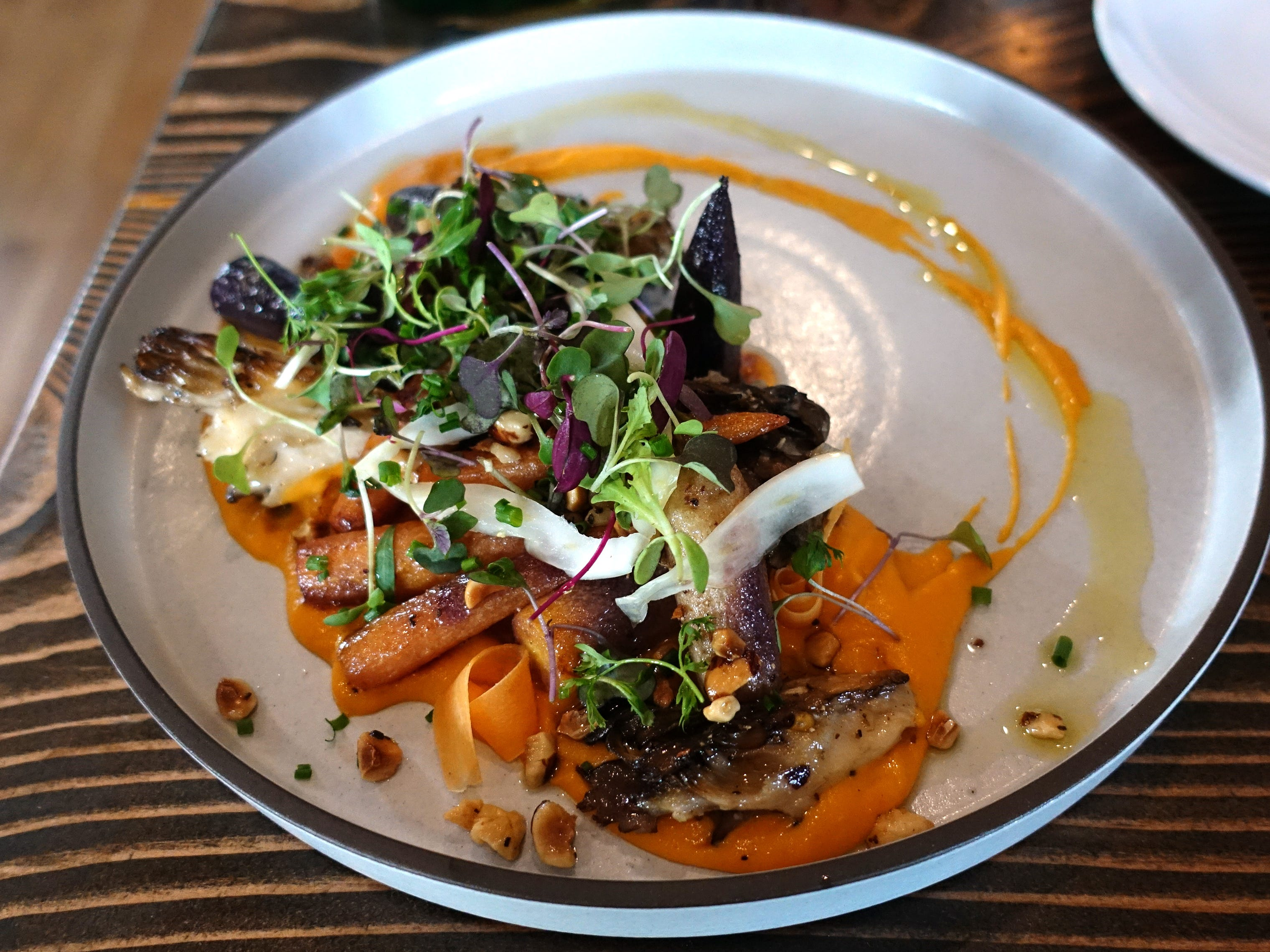 Roasted carrots with sweet potato puree, maitake mushrooms, hazelnuts and pickled fennel at Hidden Kitchen in Phoenix.