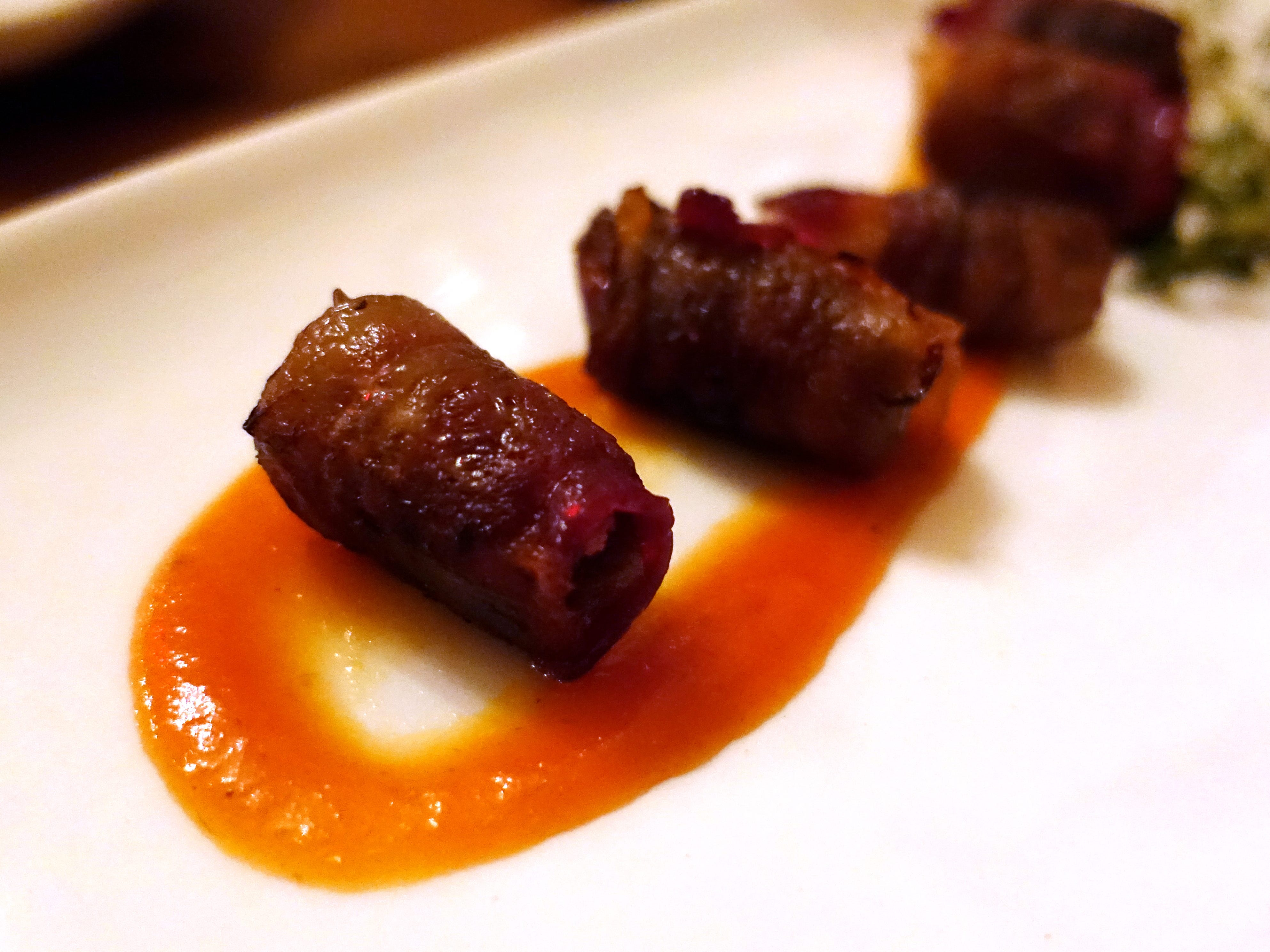 'The Dates' stuffed with Portuguese chorizo, wrapped in bacon with tomato jam at The Farish House in Phoenix.