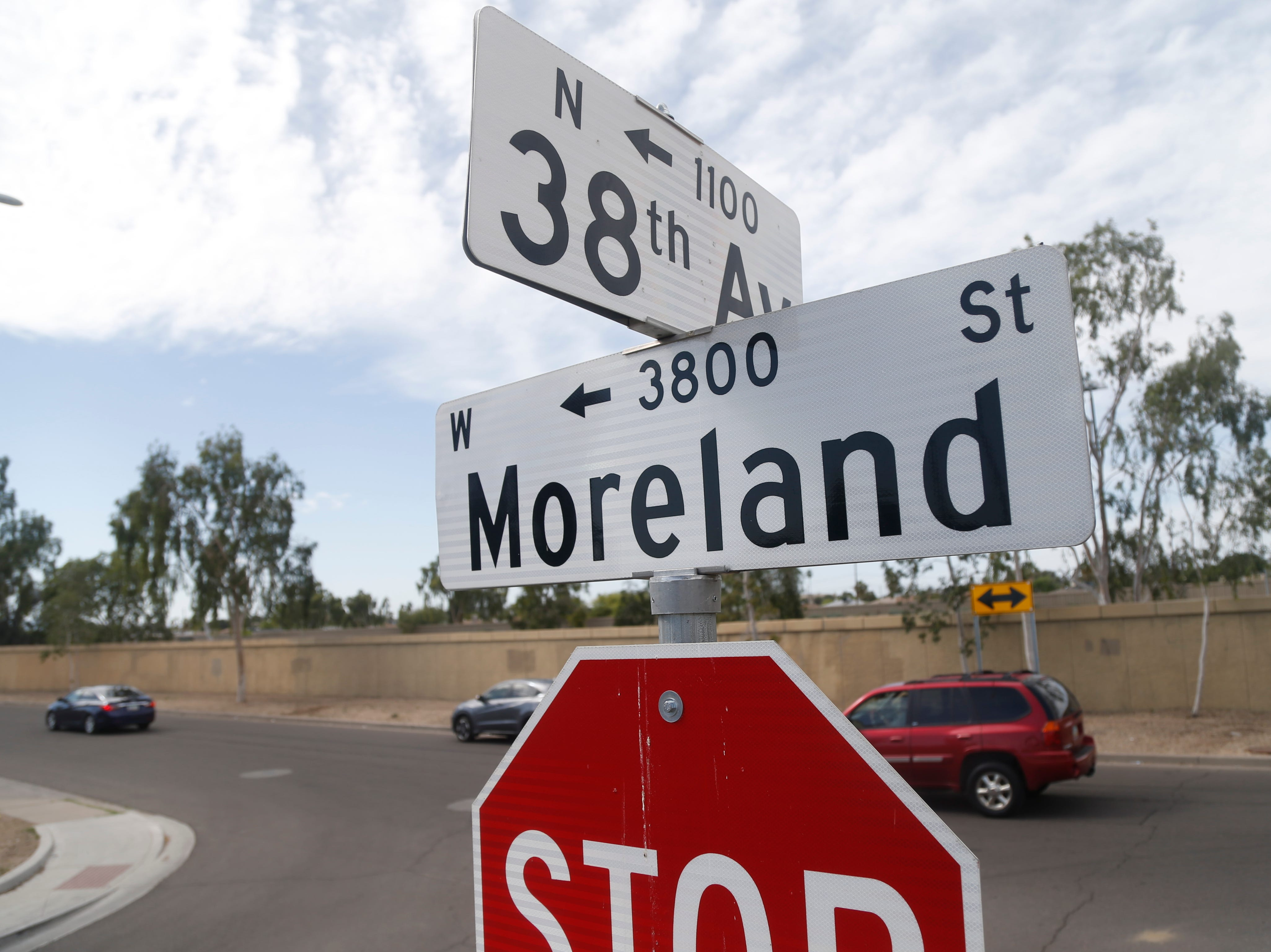 Street signs near the scene where a 10-year-old girl was shot and killed after an unexpected incident possibly involving road rage in Phoenix, Ariz., on April 3, 2019.