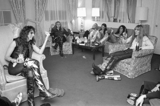 Alice Cooper, Glen Buxton, Cindy Smith Dunaway, Dennis Dunaway, Michael Bruce, Neal Smith at The One Fifth Avenue Hotel, December 1, 1971. The Alice Cooper Group was relaxing between their early and late shows at the Academy of Music in New York City.