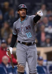 Diamondbacks' Adam Jones points to the first-base umpire during Tuesday's game in San Diego.