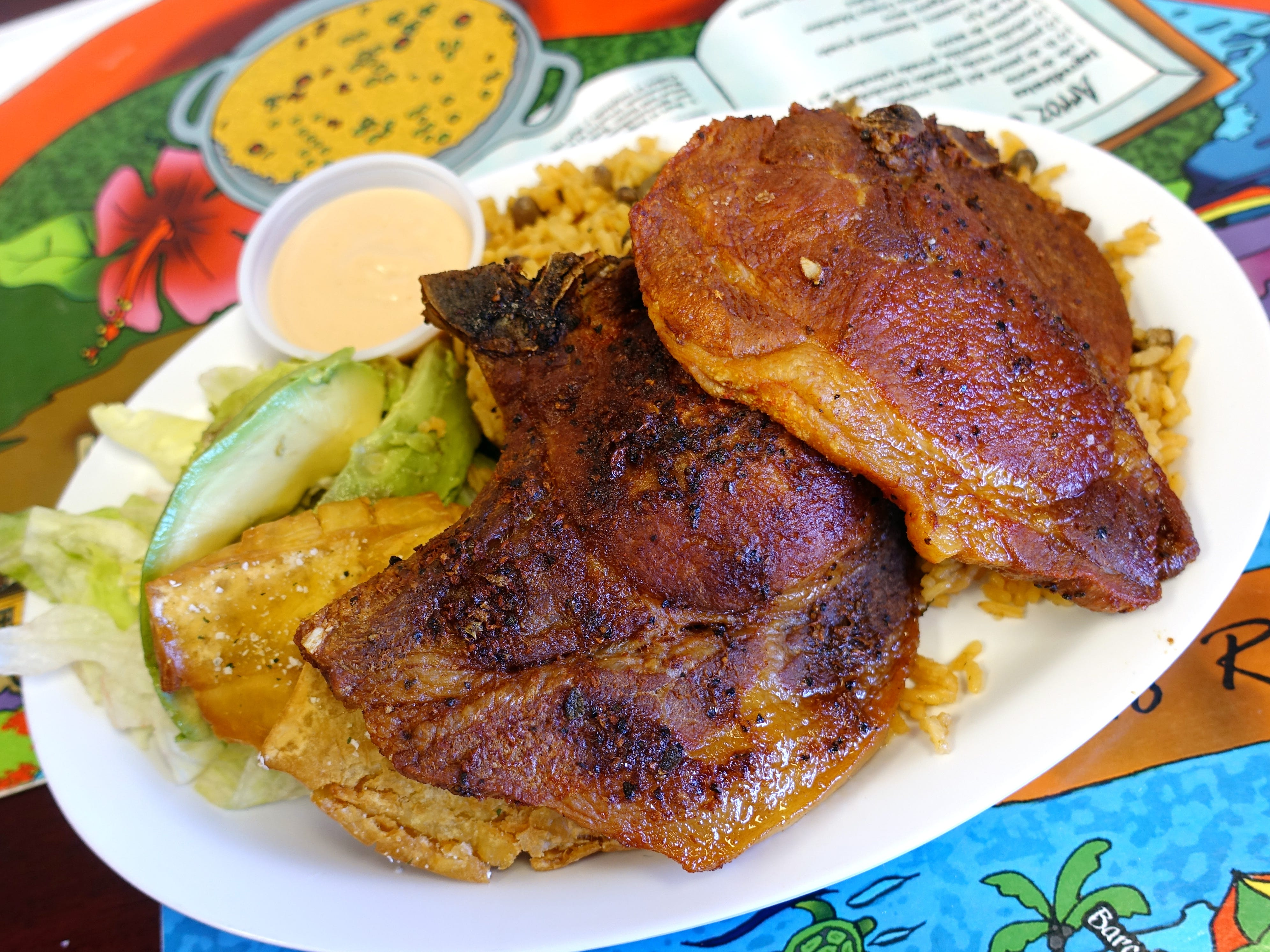 Chuletas fritas with tostones, arroz con gandules and mayoketchup at Sweet Land Cake in Phoenix.