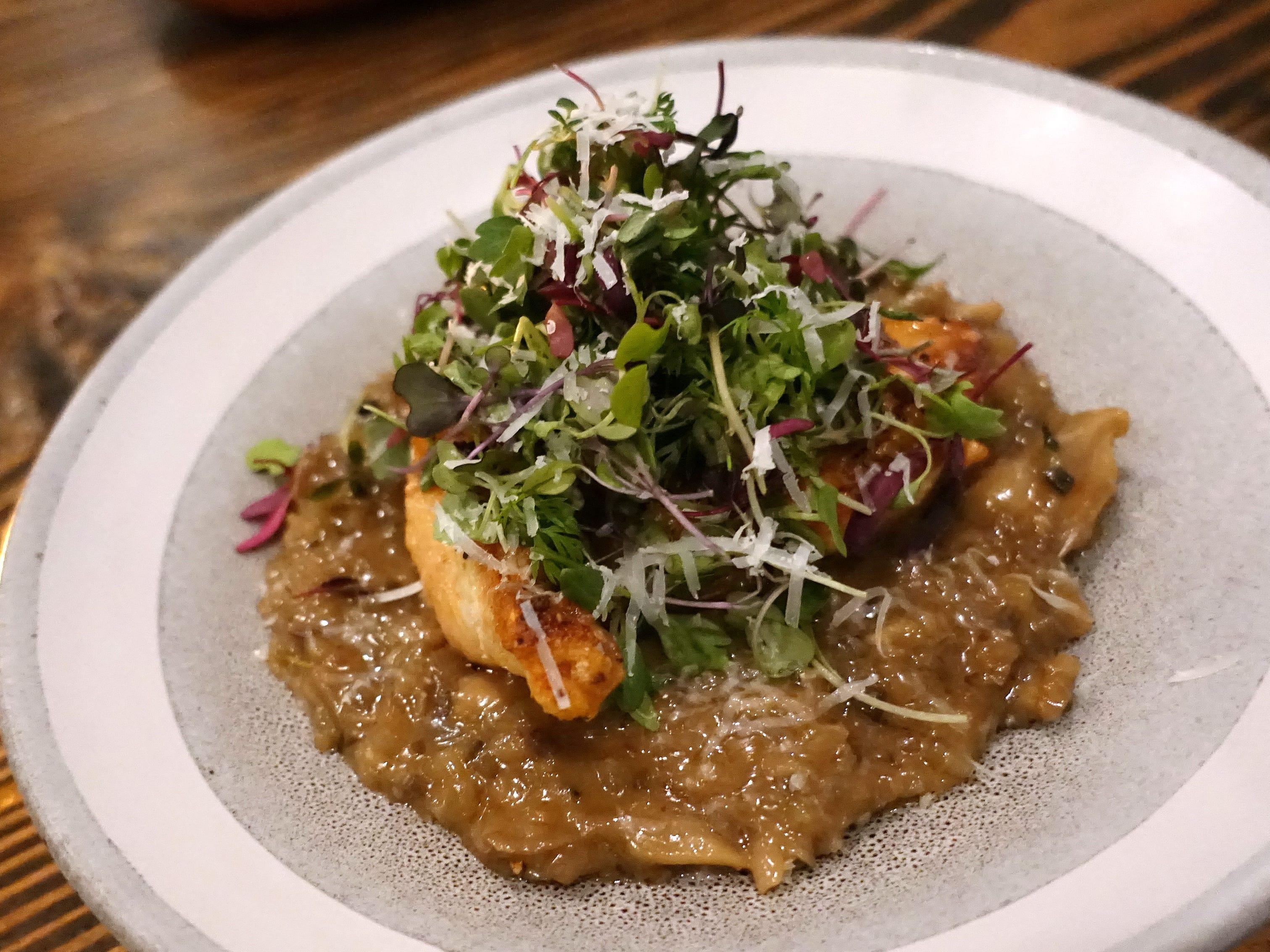 Seared chicken breast with risotto of potato, pecorino, mushroom, lemon and micro salad at Hidden Kitchen in Phoenix.