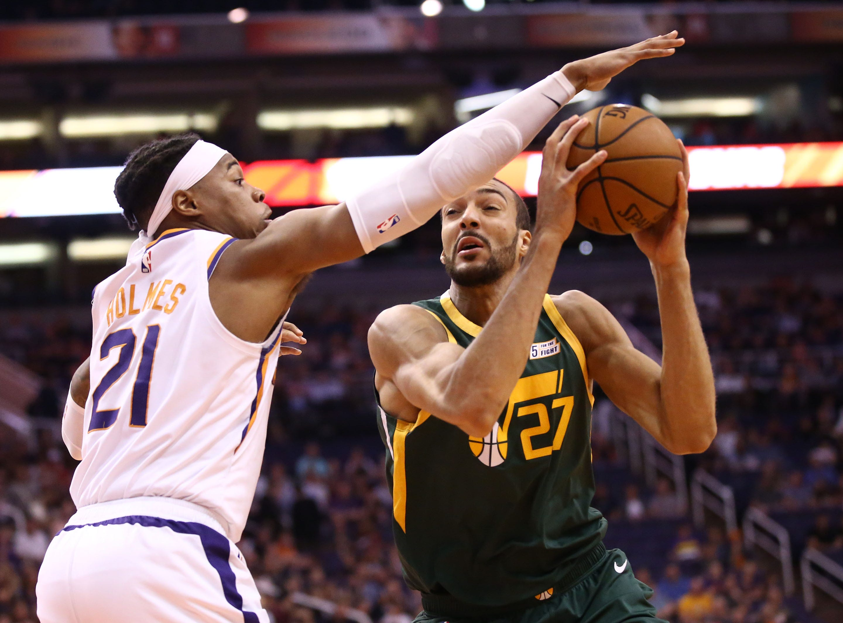 Phoenix Suns forward Richaun Holmes (21) guards Utah Jazz center Rudy Gobert (27) in the first half on Apr. 3, 2019 at Talking Stick Resort Arena in Phoenix, Ariz.