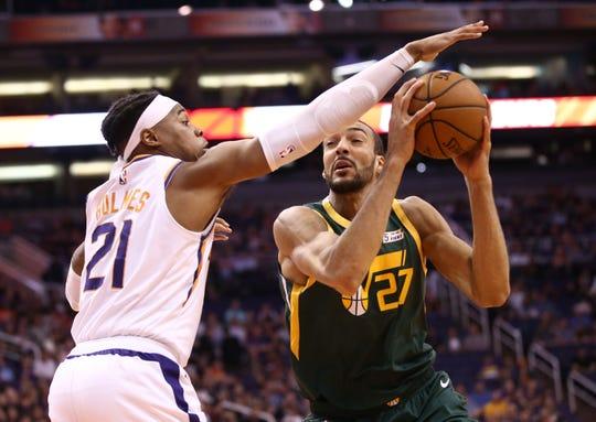 Phoenix Suns forward Richaun Holmes (21) guards Utah Jazz center Rudy Gobert (27) in the first half on Apr. 3, 2019 at Talking Stick Resort Arena in Phoenix, Ariz.