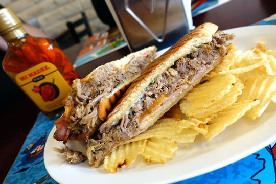 Cubano sandwich with roasted pork, ham and cheddar at Sweet Land Cake in Phoenix.