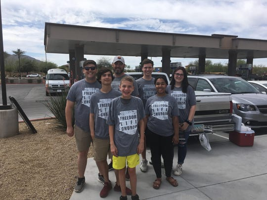 Members of Freedom Life Church in Gilbert who came out to share their good deed.
