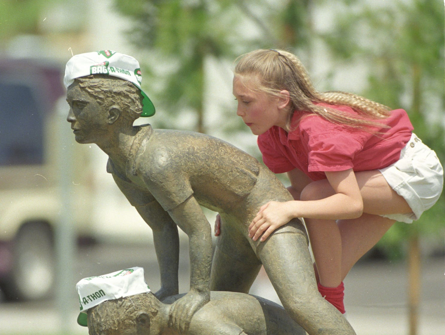 """A young girl exploring """"Children At Play,'' an art sculpture during her April 25, 1992 visit to Margaret T. Hance Park."""