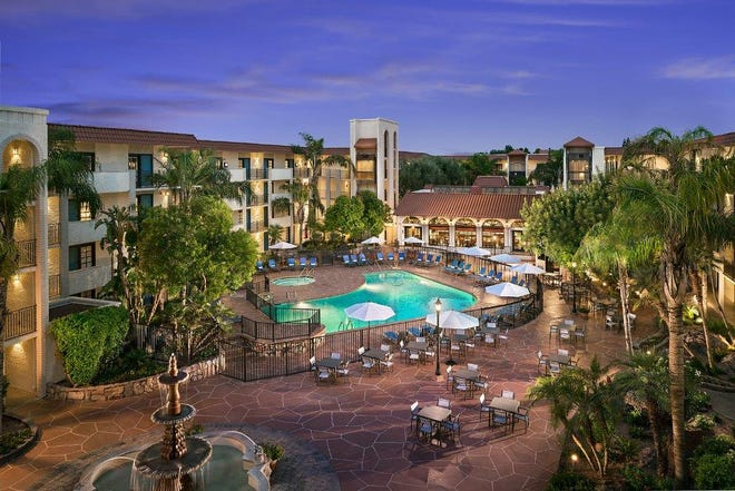 Oversized pools and spacious suites with complimentary breakfast make Embassy Suites by Hilton Scottsdale Resort perfect for families.