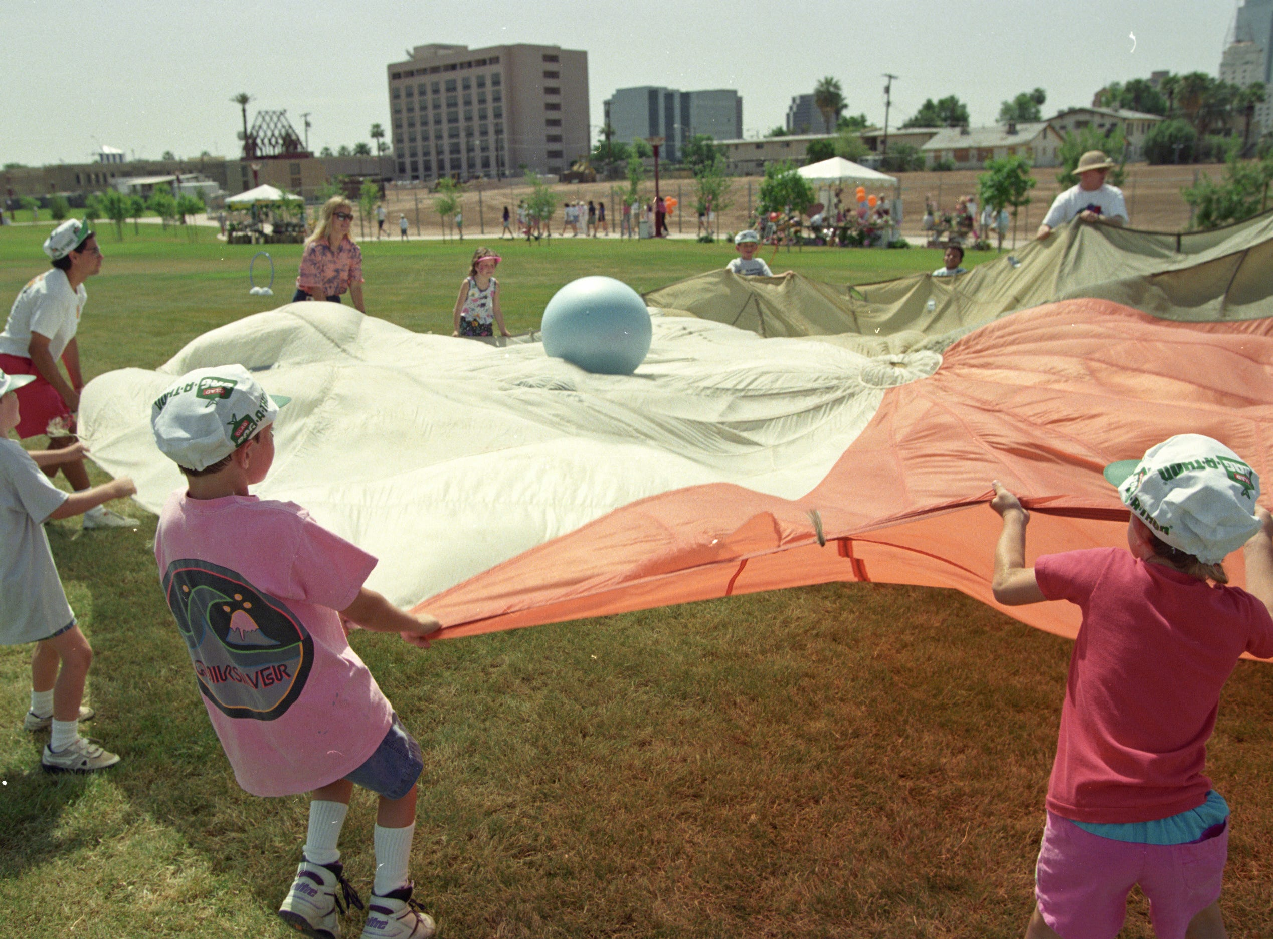 Children and adults play during the grand opening in spring 1992 of Margaret T. Hance Park in central Phoenix.