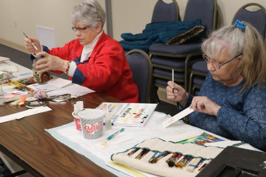 Maureen Farkas, right, and Carol Swope, left, are regular attendees at the Oak Harbor Public Library's watercolor painting class, which meets every Thursday.